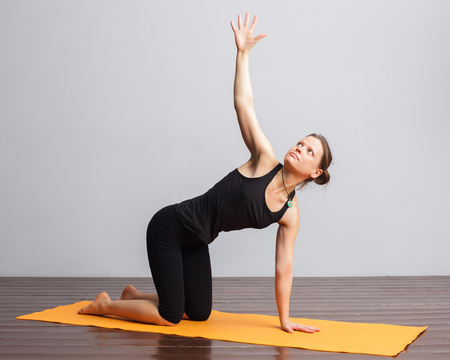 asana yoga for spine therapy. Cat Pose with a twist