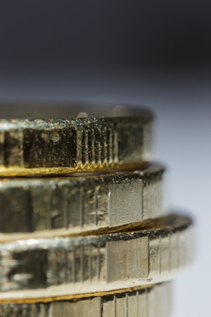Stacks of gold coins on blurred background close up