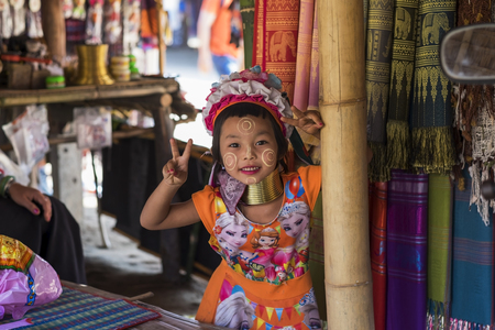CHIANG RAI, THAILAND - NOVEMBER 4 2017: Unidentified Long Neck Karen hill tribe girl smiling and showing victory sign Editorial