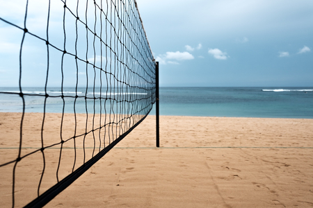 Volleyball net on the sand beach on tropical island. Sport during vacation