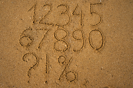 Numbers one to ten written on a sandy yellow beach. Stock Photo