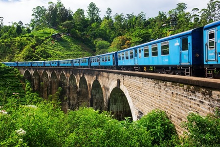 Ella Sri lanka, April 08 2018: Blue train on the Nine Arch Bridge in Ella Editorial