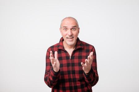 portrait of mature surprised man. Facial emotion concept
