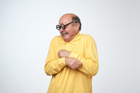 Mature man in funny glasses looking with disgust emotion on face. Bad smell concept Stockfoto - 107321980