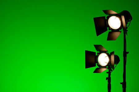 Equipment for photo studios and fashion photography. Green copyspace, lens flare effect 免版税图像