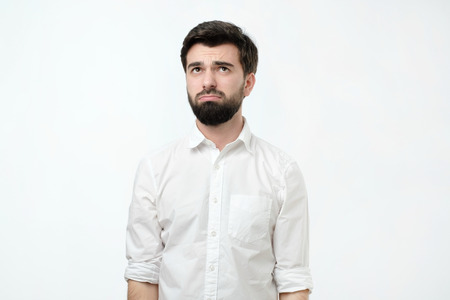 Bearded guy looking unsatisfied and tired. Sometimes everyone have a bad day.Negative facial emotion.