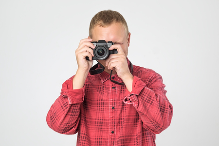 Handsome young man holding vintage old-fashioned film camera Stock Photo