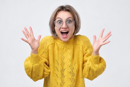 Amazed woman shouting in surprise from happiness