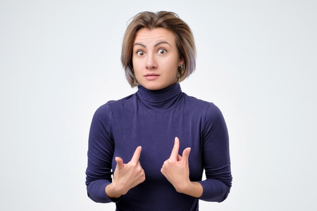 Woman verbally defending herself, having perplexed expression Stock Photo