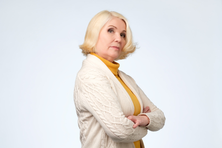 Senior blond woman looking with proud and arrogant emotions