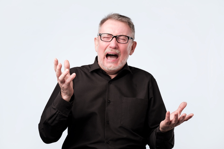 Angry shocked man screaming, isolated on white background.