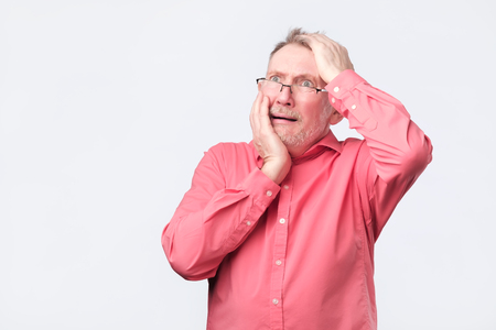 Senior guy looking unsatisfied and tired. He has a bad day, thinks about his problems at work. Reklamní fotografie