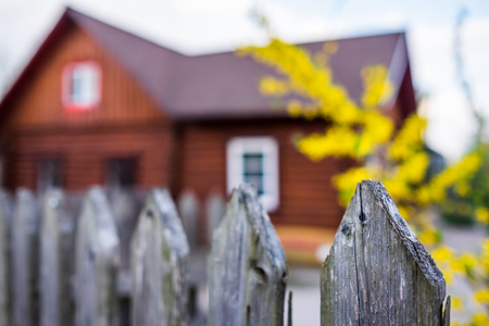 Traditional village house with wooden fence at russian rural countryside. Reklamní fotografie