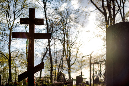 Grave cross on the Orthodox Christian cemetery at sunny day in Russia 写真素材 - 122472100