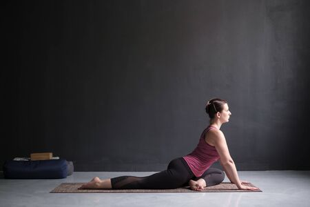 woman working out doing easy variation of One Legged King Pigeon Pose