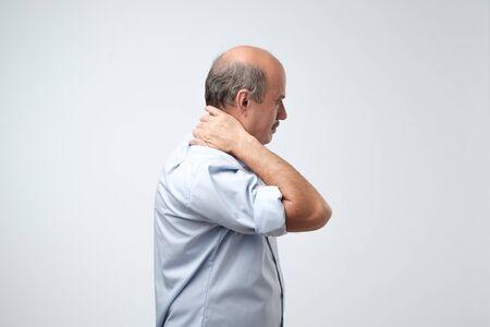 Old hispanic man with neck pain because of injury