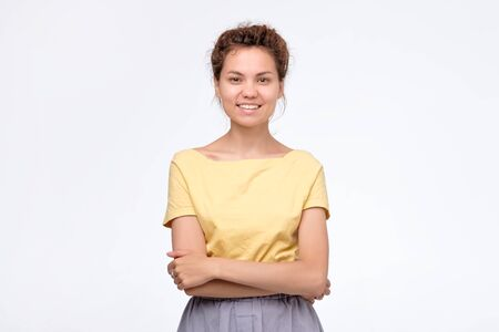 Cheerful ethnic girl in yellow t-shirt smiling confident