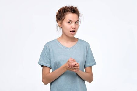 woman with dreadlocks standing opening mouth in surprise Imagens