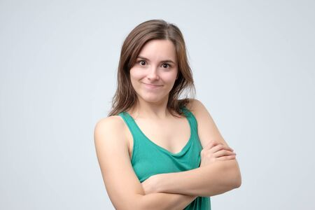 Cheerful happy young beautiful girl looking at camera smiling Imagens