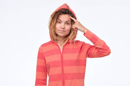 Ethnic young woman with dreadlocks in hood having a great idea