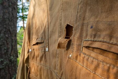 Hole in an old pair of pants drying outdoor