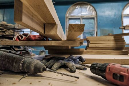 Workshop of carpenters with different types of plank.