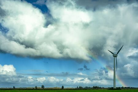 Cloudy sky and wind turbines generating electricity in Germany Stok Fotoğraf