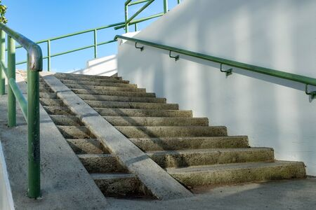 ramp for the wheelchair and stairs in an urban environment