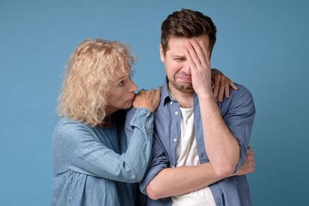 supporting woman consoling and comforting sad worried man