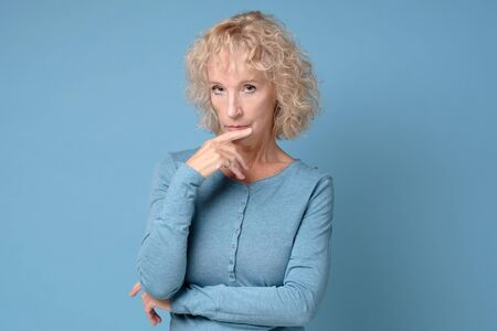 Middle aged lady looking away thinking of loneliness, getting older