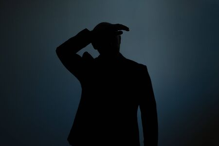 Silhouette of a tired man. Anonym and no face. Studio shot 写真素材