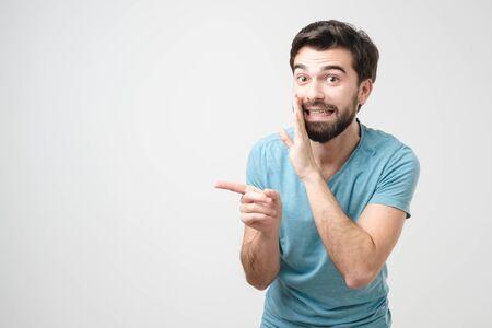 Hispanic bearded man whispering gossip isolated on a white background