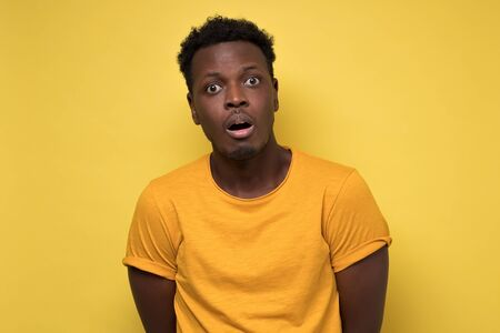 Young african american black man surprised face expression