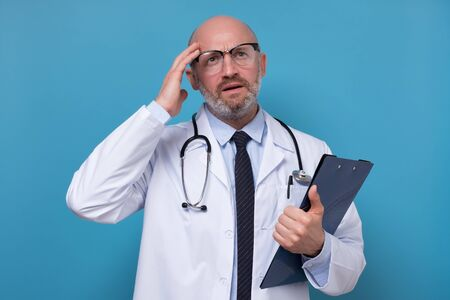 Doctor thinking about diagnosis being confused with medical exam results