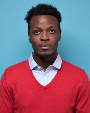 Portrait of real black african man with no expression for ID or passport photo.
