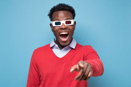 African american man in 3D glasses watching interesting movie on screen.