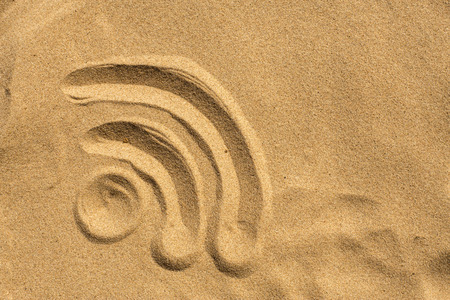 wireless sign drafted in the sand on the beach