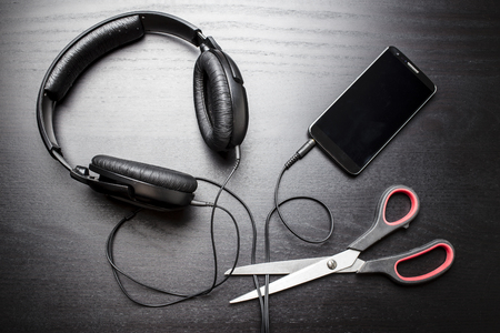 hijack: Scissors cut the wire from the headphones, leading to the phone, and thus stop the very loud illegal pirated music downloaded from the Internet