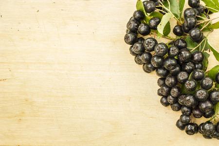 bunch of fresh chokeberry lying on the cutting board