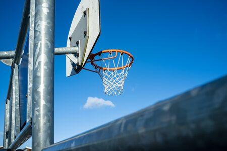 Basketball hoop on a background of blue sky.