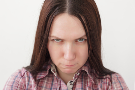 frowns: Girl frowns and looks forward with displeasure. She was disappointed and angry