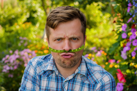 young funny man makes a funny face Stock Photo