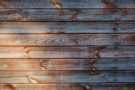 grungy: Brown scratched wooden board with light at left corner.