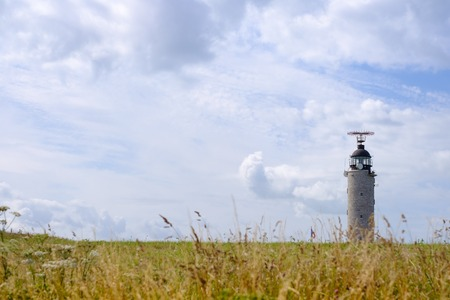 manche: CAP CRIS-NEZ, FRANCE - JULY 21 - Lighthouse on field with yellow grass Editorial
