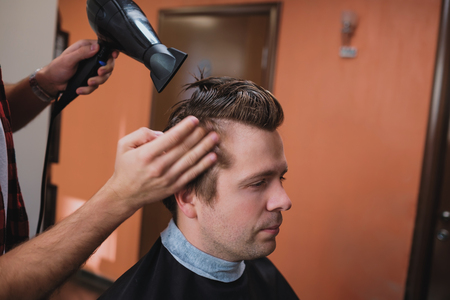 dryer: Barber using hair dryer and comb