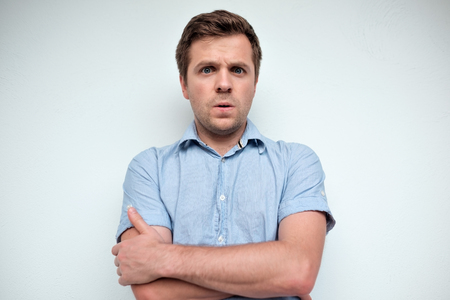 Confused caucasian man. Negative emotion Stock Photo