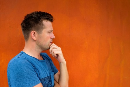 Side view portrait of thinking caucasian young man looking away