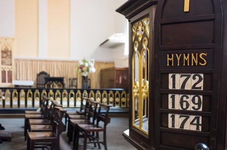 Detail of christian chirch with hymn numbers inside