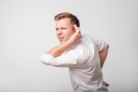 Caucasian man having hearing problem listening to something Standard-Bild - 102989065