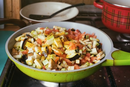 Cooking vegetable in pan for dinner.